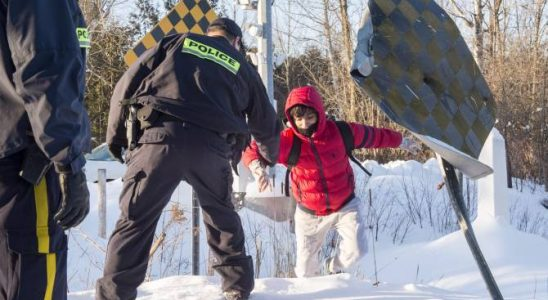 Family members from Somalia are escorted by RCMP officers after crossing the U.S.-Canada border