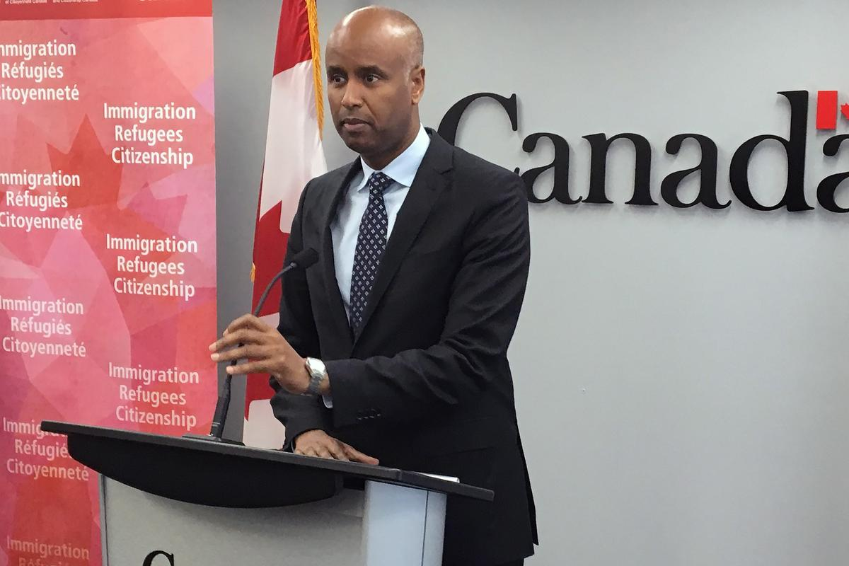 Ahmed Hussen, the federal minister of Immigration, Refugees and Citizenship, speaks during a press conference in Halifax on Monday. Hussen, himself an immigrant from Somalia, says Canada has a legal obligation under national and international law to give a fair hearing to refugee claimants.