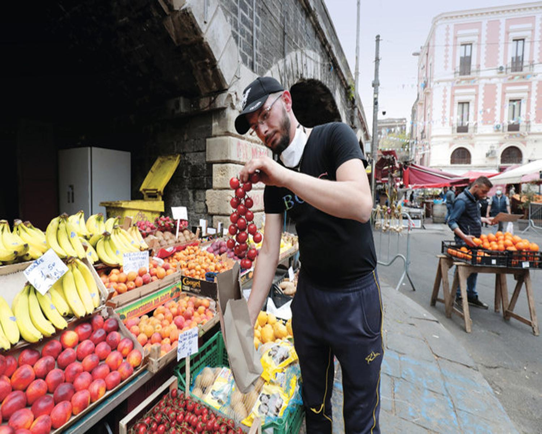 Italy grants 500,000 undocumented migrants work permits
